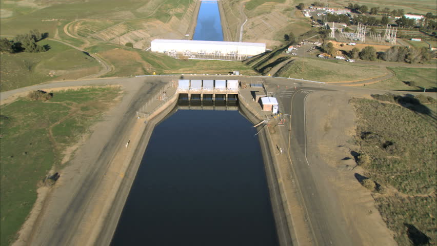 Aerial view over manmade irrigation chanel & hydro-electric dam