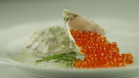 Serving Red Salmon Caviar with Seashells in Luxury Restaurant Shot on RED Cinema Camera in 4K (UHD). ProRes codec - Great for editing, color correction and grading.
