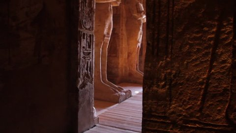 Statue of Osiris in the entrance hall of the Temple of Ramesses II. Tilt up. 1080p high definition.