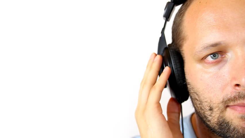 male worker wears headphones - 852×480