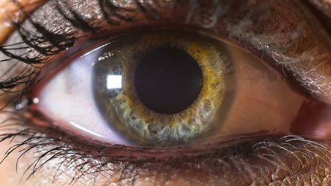 iris pupil contracting slowmotion,female green make up eye