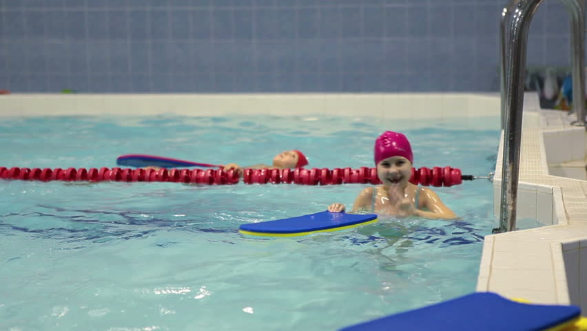 Young girl has training in swimming pool. Russian swimming sport school for preschoolers | Shutterstock HD Video #8507866