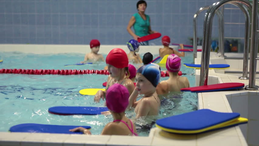 Young Girl Has Training In Swimming Pool Russian Swimming Sport School For Preschoolers Stock