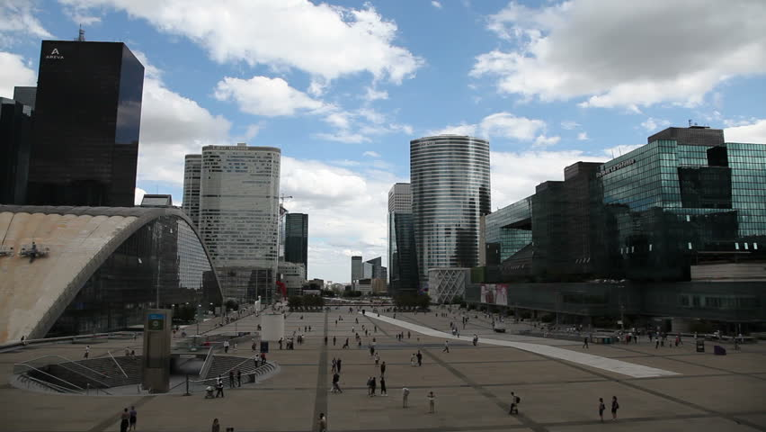PARIS - AUGUST 7: Tourists and locals walk in La Defense August 7, 2010  in Paris. La Defense is a major business district in the metropolitan area of Paris, France.