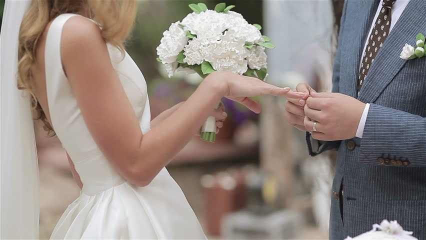 Delightful On A Wedding Day Groom Puts A Wedding Ring On Finger Of A Bride. Bride Puts  A Ring On Finger Of A Groom Stock Footage Video 8542366 | Shutterstock Design