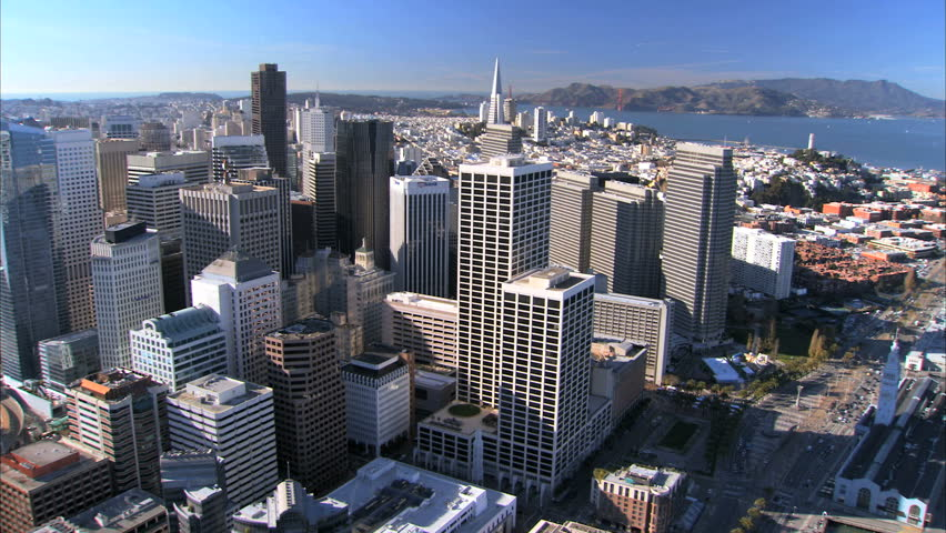 Flying over the city of San Francisco & it's towering skyscrapers