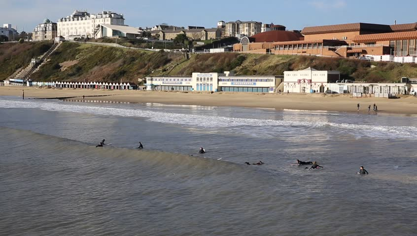 Surfers on Bournemouth beach Dorset England UK near to Poole known for beautiful sandy beaches