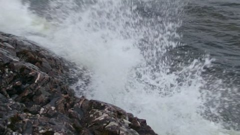 Gale-Force Winds over Lake Superior, waves and whitewater splashing high while crashing into beaches and rocky shoreline.