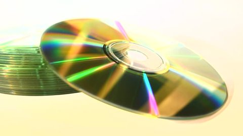Business Computers Technology Media Stack of Blank CDs - isolated on white background with focus moving out towards end of clip.