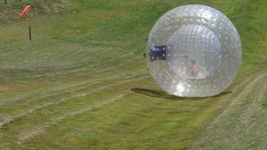 ROTORUA, NZL - JAN 18 2015:Visitor rides in ball rolling OGO Zorbing Rotorua.OGO Rotorua is now the only ball rolling operation in New Zealand to be Adventure Activity Safety Audit Certified.
