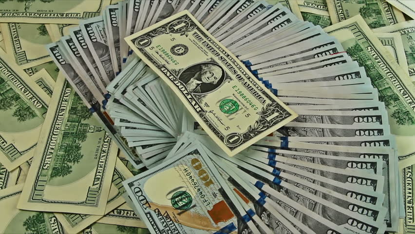 Cash money background close-up rotation. 100 US dollars on the top of usd banknotes heap | Shutterstock HD Video #8627326