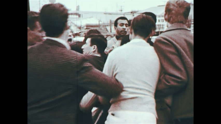 UNITED STATES 1960s : A group of people get into a fight after a car accident. | Shutterstock HD Video #8635696