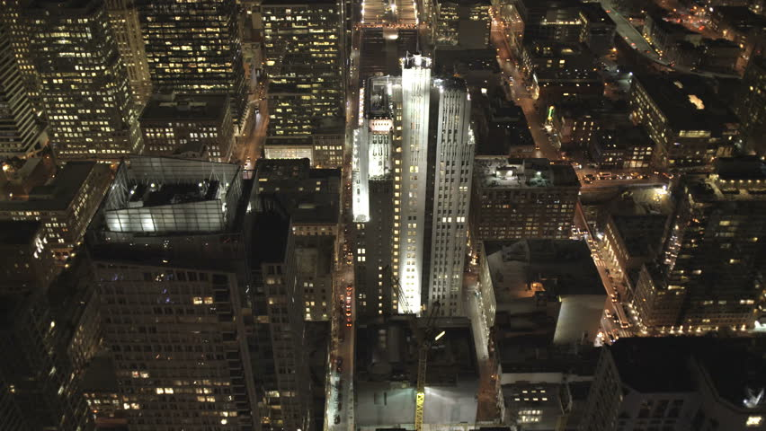 Aerial low level overhead night illuminated rooftop view Downtown Skyscrapers commuter traffic San Francisco California USA 4K | Shutterstock HD Video #8655046