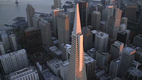 Aerial low level sunset view Transamerica Pyramid building Downtown city Skyscrapers San Francisco California USA 4K
