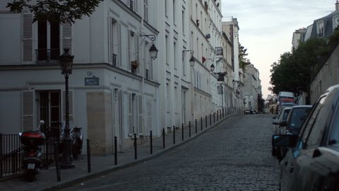 PARIS FRANCE- JULY 2, 2014:  A typical street of Montmartre early in the morning