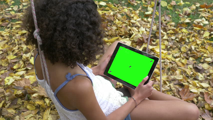 Young Girl with Tablet, Green Screen, Wide Shot