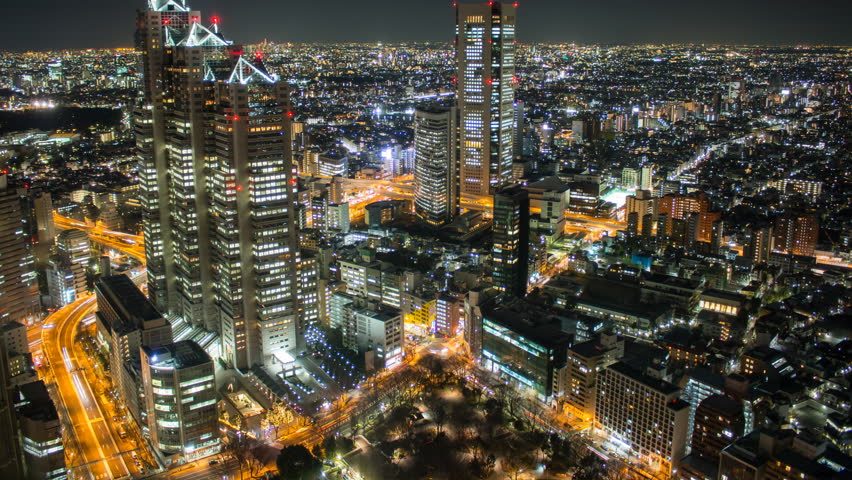 4k time lapse taken from a high vantage point in Shinjuku Tokyo Japan looking west. Camera tilts up as the clip progresses. | Shutterstock HD Video #8692126