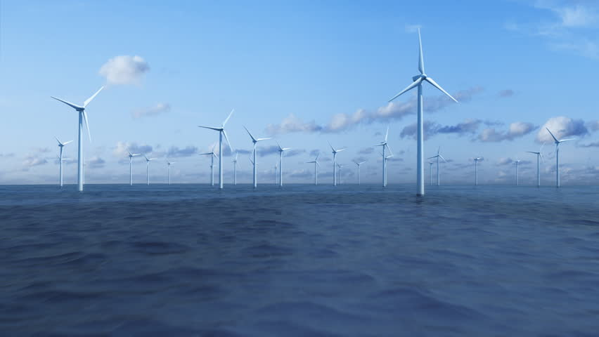 Camera flying over the ocean trough a farm of wind turbines. | Shutterstock HD Video #873046