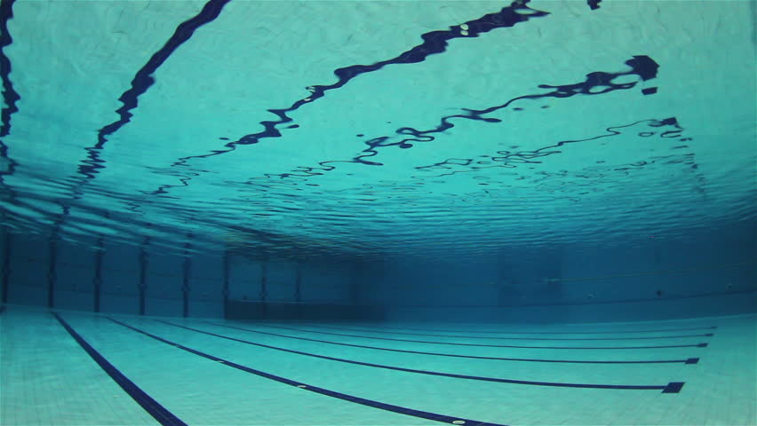 empty olympic swimming pool underwater with surface ripples hd stock video clip