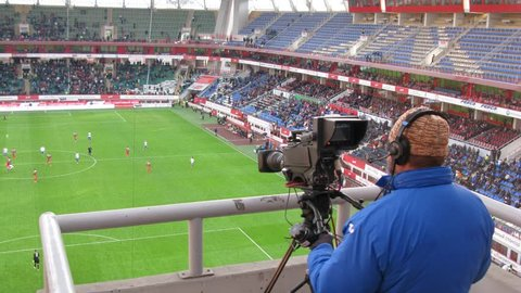RUSSIA, MOSCOW - NOV 02, 2014 (Time Lapse): Close-up of operator shoots video of football match on the field of Locomotive sports arena in Cherkizovo.