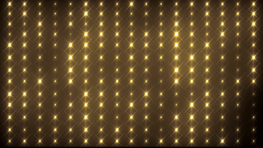 Disco spectrum lights concert spot bulb. Abstract motion background in gold colors, shining lights, energy waves and sparkling particles.  Seamless loop. More sets footage  in my portfolio.   Shutterstock HD Video #8753956