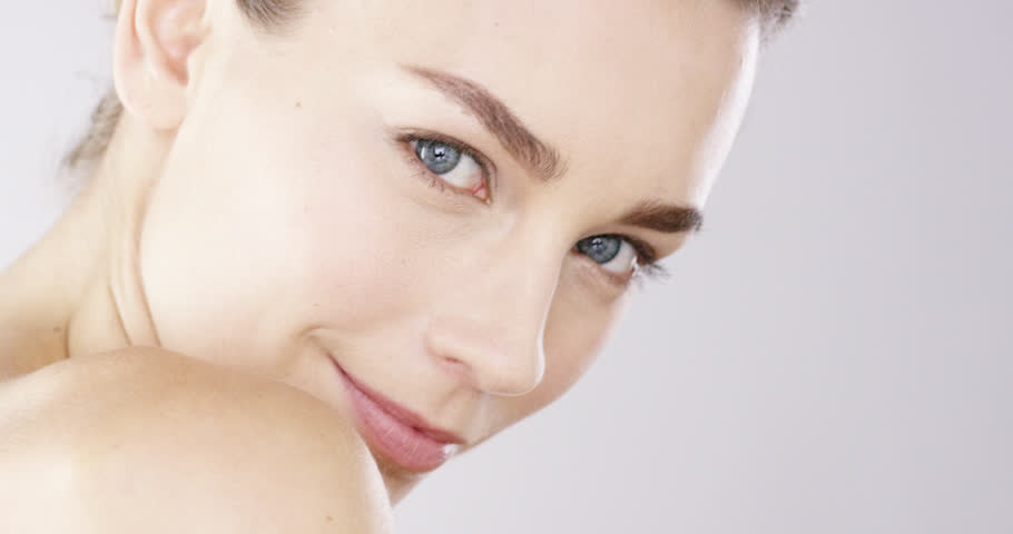Closeup Beauty portrait of woman face with bright blue eyes skincare concept - Red Epic Dragon