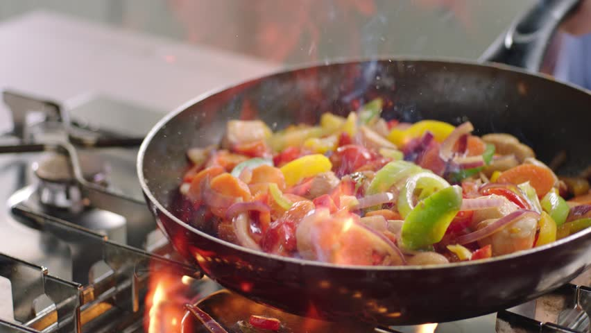 Flaming vegetables and chicken. | Shutterstock HD Video #8773288