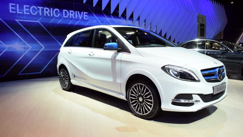BRUSSELS, BELGIUM - JANUARY 15: White Mercedes Benz B-Class Electric Drive compact electric luxury car on display during the 2015 Brussels motor show. | Shutterstock HD Video #8828506
