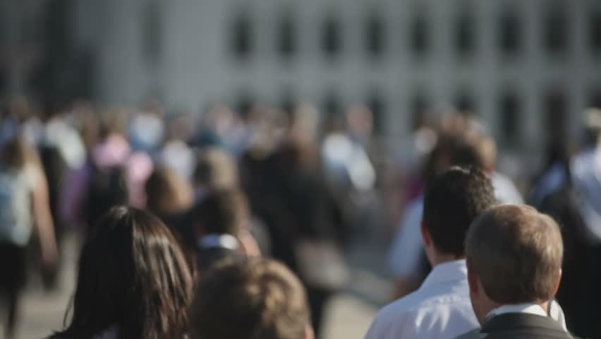 Hi-mo large crowd of pedestrians walk over London Bridge 03   Shutterstock HD Video #8846296