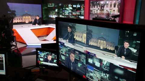 MOSCOW, RUSSIA - FEBRUARY 11, 2015: News anchor in the Studio of the TV channel. Set of cameras and monitors.