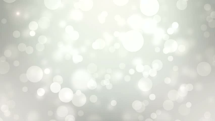 Moving gloss particles on grey background loop. Soft beautiful backgrounds. Circular shapes perform dance. motion background. More sets footage  in my portfolio.   Shutterstock HD Video #8872576
