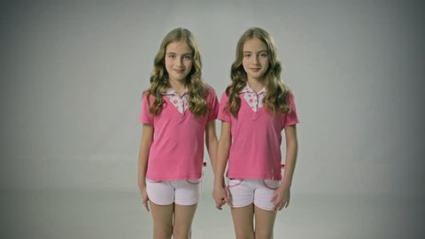 Good looking and loving twins. Sisters. Smiling. Adorable. Happy lifestyle kids.