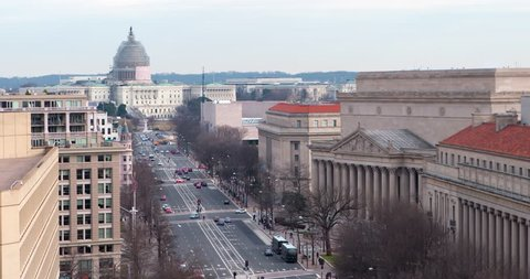 US Capitol and Pennsylvania Avenue Winter January 2015 scaffolded US Capitol dome with FBI Building on the left and The National Archives on the right.