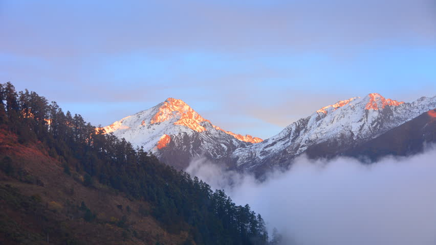 Above the clouds - Himalayas mountains in moving fog and clouds Nepal timelapse