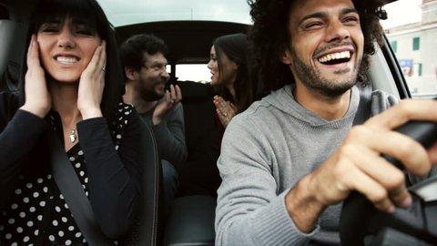friends driving car taking wrong street having fun
