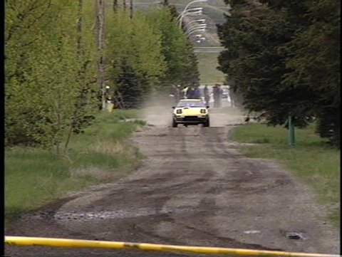 off road rally race, spectator stage, straight section, classic Mazda RX7 (good audio)