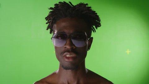 4K African black stylish man smile. Gold teeth. Grills, grillz. RAP style. Golden teeth. On green screen. Few shots. Shot on RED EPIC Cinema Camera.