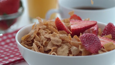 Strawberries falling into cereal in slow motion; shot on Phantom Flex 4K at 1000 fps