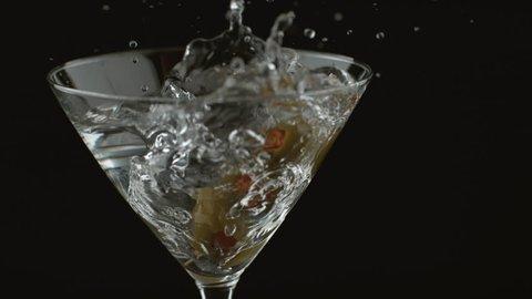 Slow motion shot of olives splashing into martini; shot on Phantom Flex 4K at 1000 fps