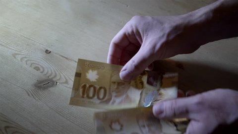 Counting $100 Canadian bills. Filmed in 4K UHD.