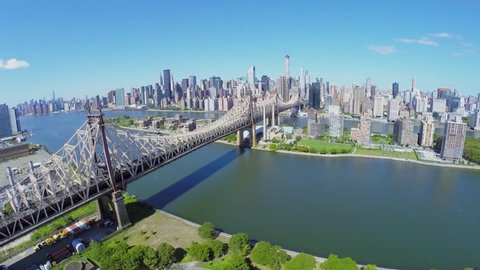 Queensboro Bridge with traffic at summer sunny day in New-York City. Aerial view