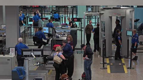 SALT LAKE CITY, UTAH - SEPT 2014: Salt Lake City Utah TSA security check airport. Department of Homeland Security that has authority over the security. Passengers checked for explosives and weapons.
