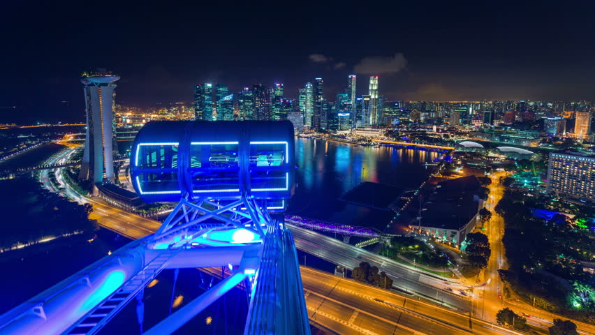 singapore - october 2014: night light singapore flyer famous view 4k time lapse, singapore.