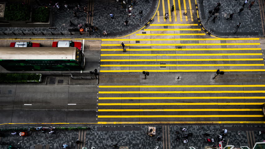 Hong Kong,China-Nov 12,2014: The bird view of the traffic and pedestrians in the downtown of Hong Kong,China  | Shutterstock HD Video #9014476
