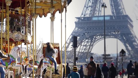 PARIS, FRANCE - FEBRUARY 2013;  Slow motion of a famous carousel in front of Eiffel tower - close up - 1080p