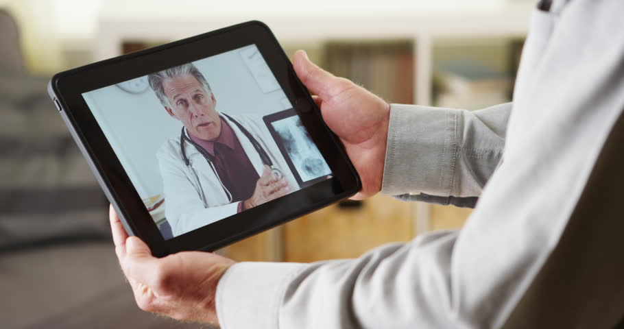 Doctor talking to patient online about xrays