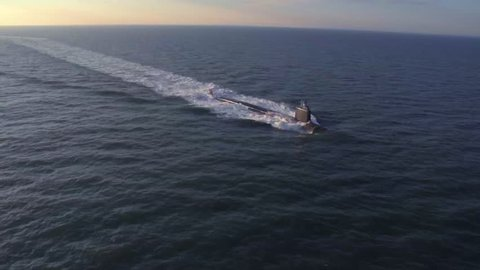 CIRCA 2010s - Excellent aerials over a submarine at sea.