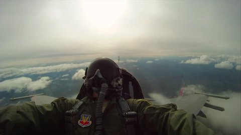 CIRCA 2010s - POV shots from the cockpit of a fighter plane doing barrel rolls.