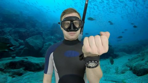 Diving sign- divemaster  shows sing  ASK QUASTIONS  ,also a available on the green screen all of diving sings from course (open water diver)  8   of 11