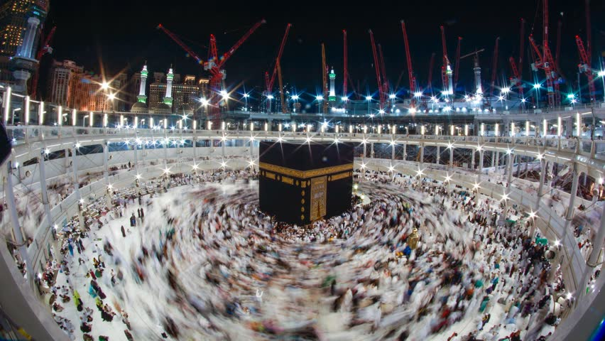 Time-lapse of pilgrims circumambulate the Kaaba in the evening in 4K. DCI 4K, 4096 x 2160p (Cinematic cinemascope display)